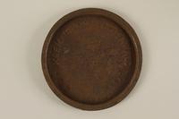 1993.157.1 front Buchenwald crematorium ash can lid  Click to enlarge
