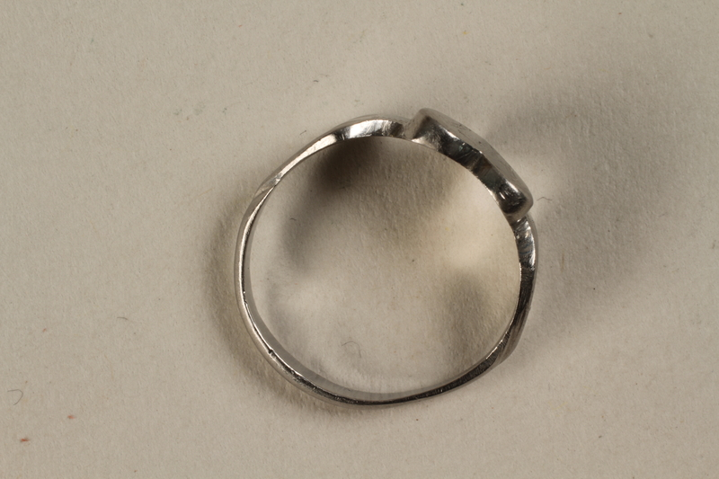 1993.158.1 side Engraved heart shaped ring crafted from munitions parts and made in secret in a slave labor camp