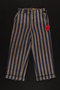 Concentration camp uniform pants with red triangle patch worn by Polish Jewish inmate