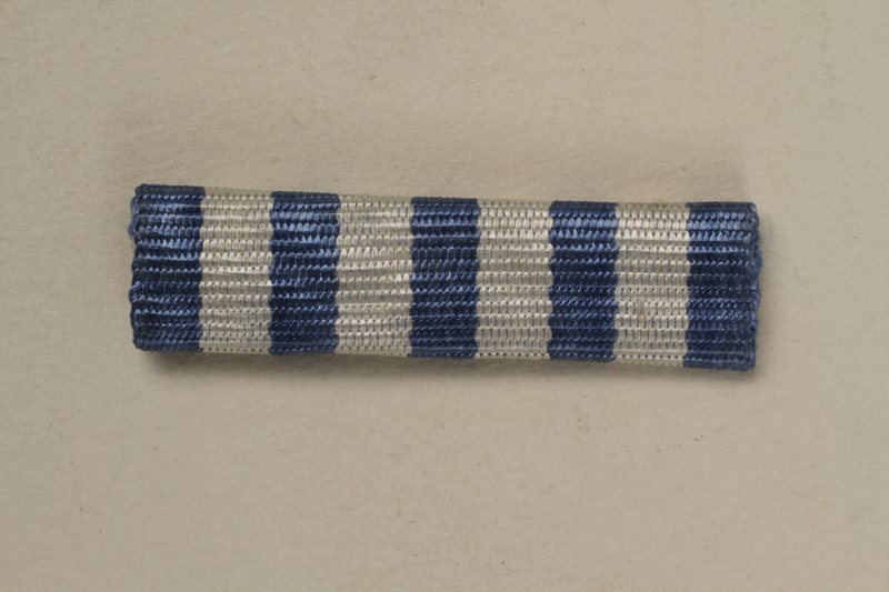1993.167.5 front Blue and white striped ribbon bar for a Yugoslavian partisan