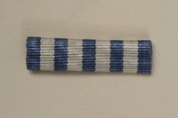 1993.167.5 front Blue and white striped ribbon bar for a Yugoslavian partisan  Click to enlarge