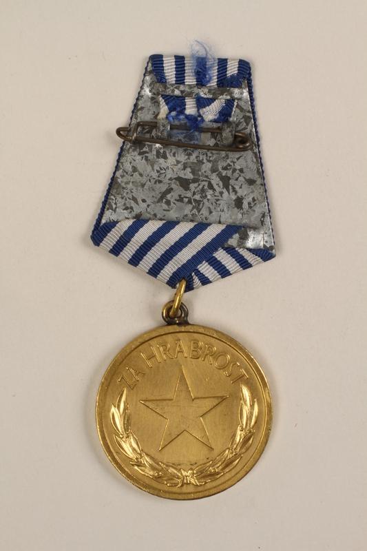 1993.167.6 back Medalja za Hrabrost awarded to a Yugoslavian partisan