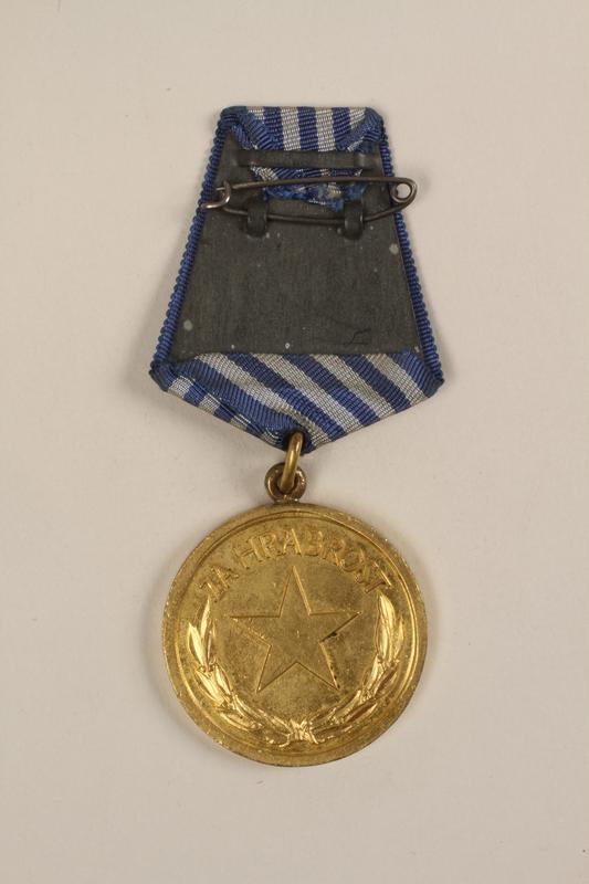 1993.167.7 back Medal of Honor awarded to Yugoslav partisans for bravery