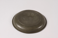 2012.456.2 bottom Shallow pewter bowl with etched Hebrew owned by a German Jewish prewar emigre  Click to enlarge