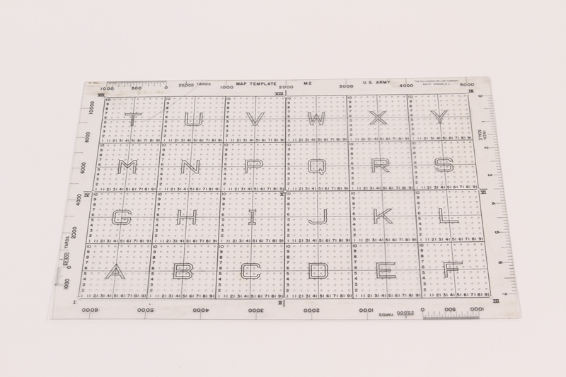 2003.149.81 front U.S. Army M2 clear plastic map template grid used by German Jewish US soldier