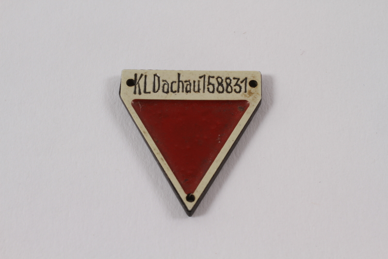2012.459.2 front Commemorative red triangle Dachau badge 158831 owned by former inmate