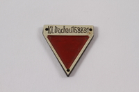 2012.459.2 front Commemorative red triangle Dachau badge 158831 owned by former inmate  Click to enlarge