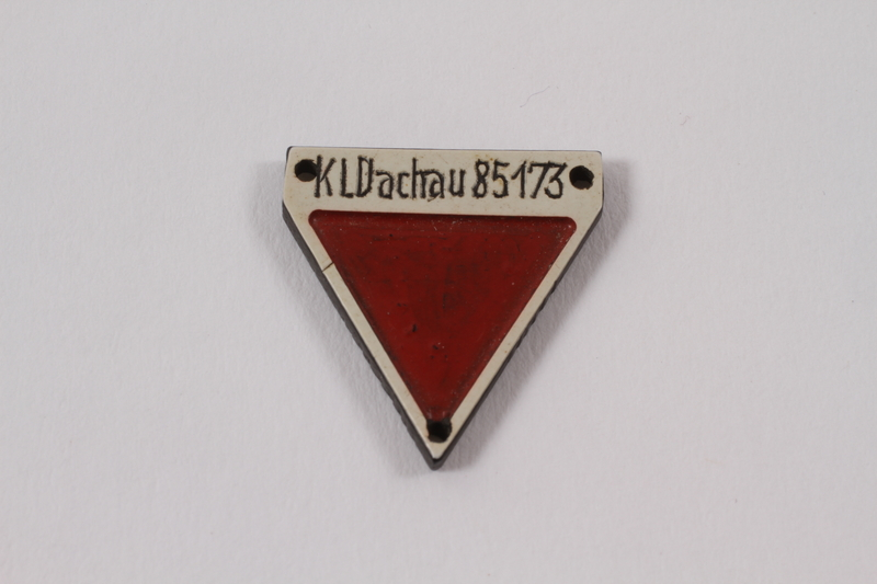 2012.459.3 front Commemorative red triangle Dachau badge 85173 owned by former inmate