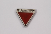 2012.459.3 front Commemorative red triangle Dachau badge 85173 owned by former inmate  Click to enlarge