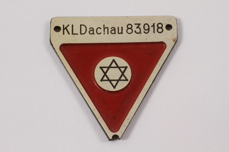 2012.459.4 front Commemorative red triangle Dachau badge 83918 owned by former camp inmate