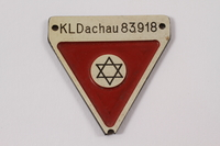 2012.459.4 front Commemorative red triangle Dachau badge 83918 owned by former camp inmate  Click to enlarge