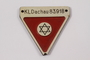 Commemorative red triangle Dachau badge 83918 owned by former camp inmate