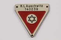 2012.459.5 front Commemorative red triangle Auschwitz badge 140239 owned by former camp inmate  Click to enlarge