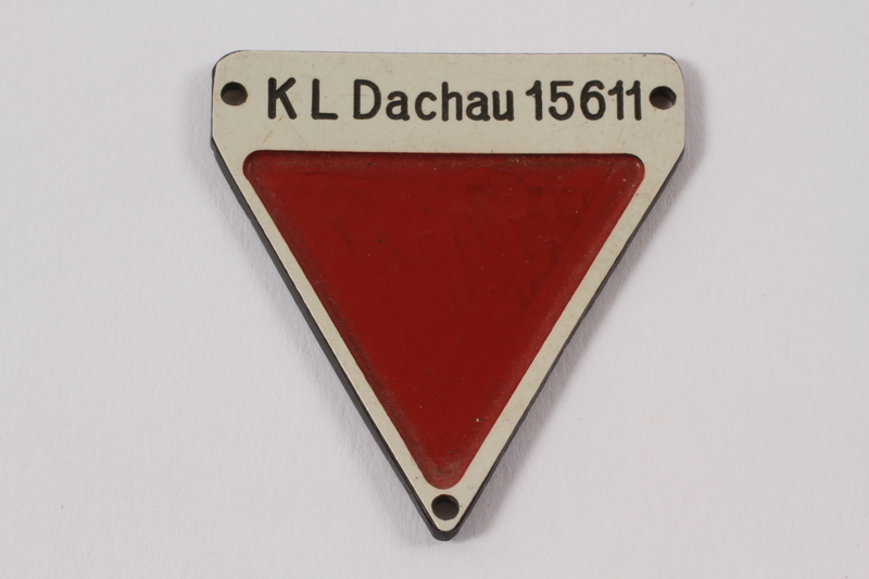 2012.459.7 front Commemorative red triangle Dachau badge 15611 owned by former German Jewish inmate