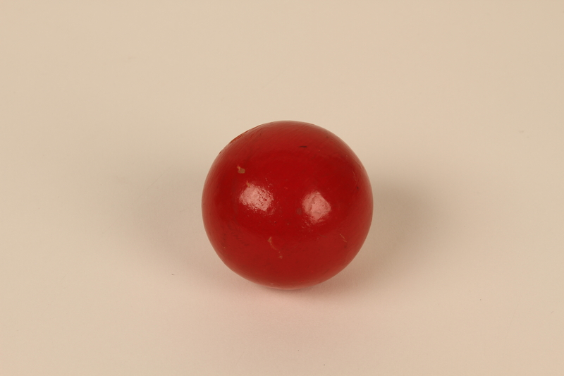 2013.319.2 front Red wooden ball returned after 50 years to the cousin of a Jewish youth killed during the Holocaust