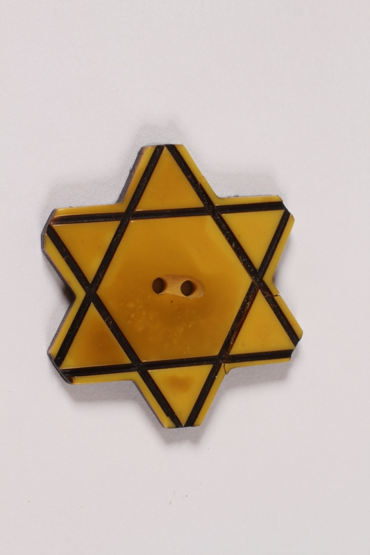 2013.335.2 front Bakelite Star of David button worn by a Bulgarian Jewish woman