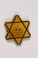 2013.335.2 front Bakelite Star of David button worn by a Bulgarian Jewish woman  Click to enlarge