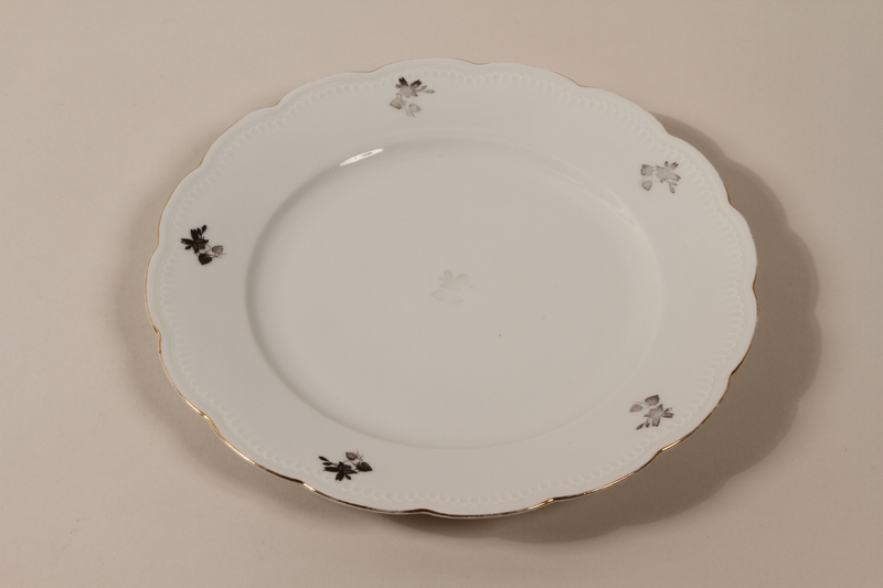 2013.355.1 a front 8 porcelain bowls and 3 matching plates received as wedding gifts and recovered postwar by a Czech Jewish woman