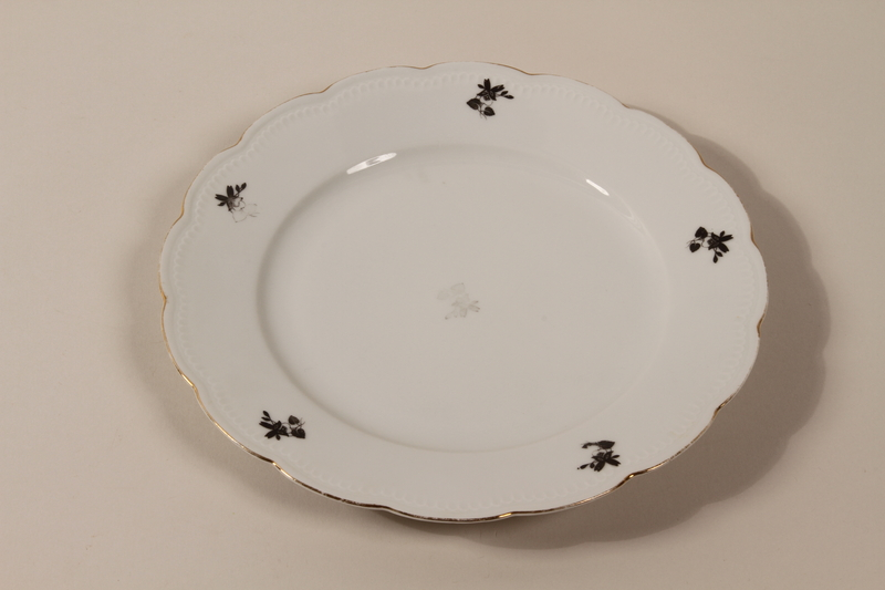 2013.355.1 b front 8 porcelain bowls and 3 matching plates received as wedding gifts and recovered postwar by a Czech Jewish woman
