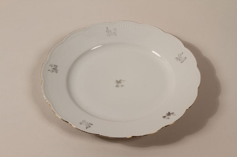 2013.355.1 c front 8 porcelain bowls and 3 matching plates received as wedding gifts and recovered postwar by a Czech Jewish woman