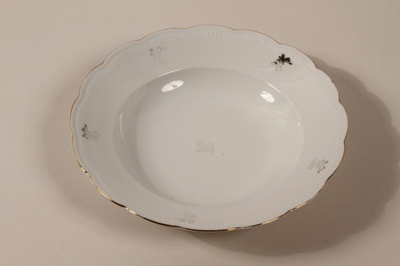2013.355.1 d front 8 porcelain bowls and 3 matching plates received as wedding gifts and recovered postwar by a Czech Jewish woman