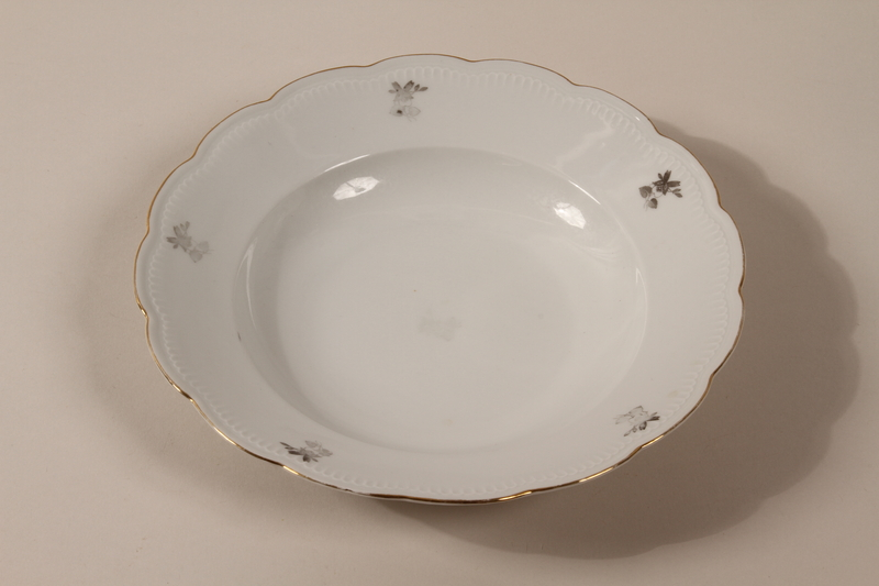 2013.355.1 e front 8 porcelain bowls and 3 matching plates received as wedding gifts and recovered postwar by a Czech Jewish woman