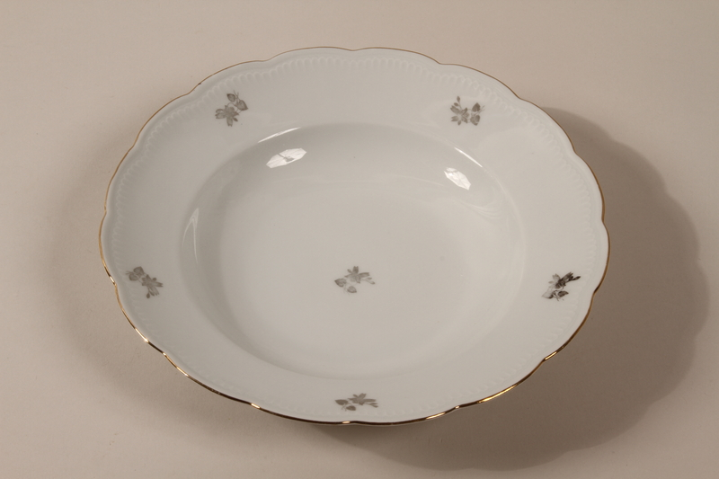 2013.355.1 f front 8 porcelain bowls and 3 matching plates received as wedding gifts and recovered postwar by a Czech Jewish woman