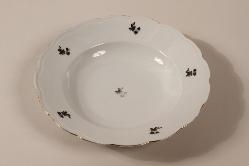 2013.355.1 g front 8 porcelain bowls and 3 matching plates received as wedding gifts and recovered postwar by a Czech Jewish woman
