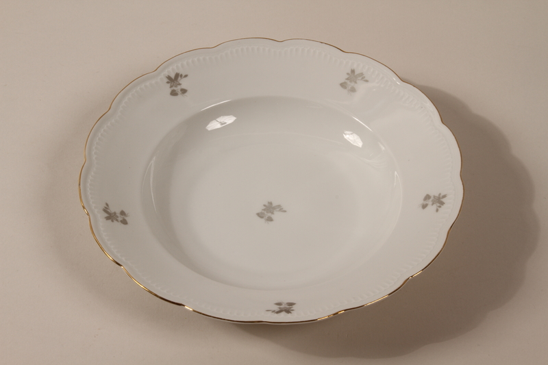 2013.355.1 h front 8 porcelain bowls and 3 matching plates received as wedding gifts and recovered postwar by a Czech Jewish woman