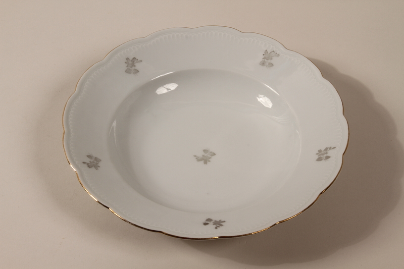 2013.355.1 j front 8 porcelain bowls and 3 matching plates received as wedding gifts and recovered postwar by a Czech Jewish woman