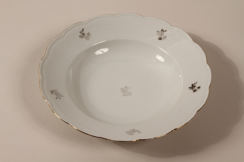2013.355.1 k front 8 porcelain bowls and 3 matching plates received as wedding gifts and recovered postwar by a Czech Jewish woman