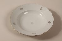 2013.355.1 k front 8 porcelain bowls and 3 matching plates received as wedding gifts and recovered postwar by a Czech Jewish woman  Click to enlarge