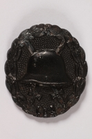 1997.A.0039.3 front World War I wound badge for a cap awarded to a German soldier  Click to enlarge