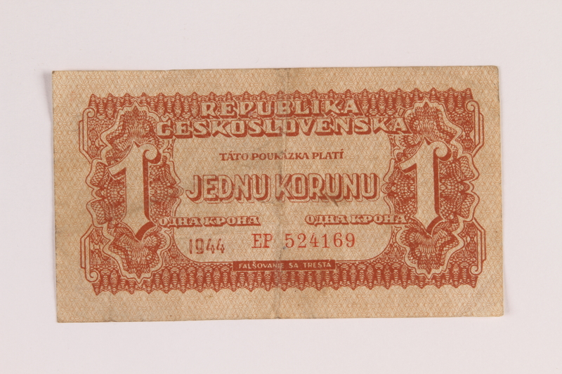 1988.68.1.6 front Republic of Czechoslovakia currency, 1 korunu note, acquired by a Jewish Polish survivor