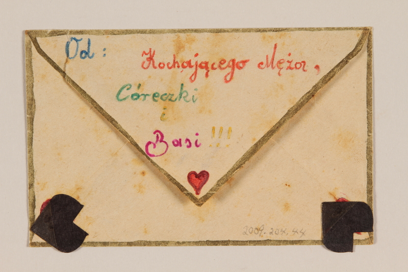2009.204.44 back Envelope decorated with hearts and a hand drawn cancelled stamp created by a former hidden child