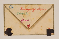 2009.204.44 back Envelope decorated with hearts and a hand drawn cancelled stamp created by a former hidden child  Click to enlarge
