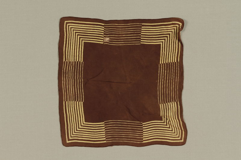 1988.99.2 front Brown and yellow striped silk handkerchief found by a German Jewish teenage inmate at Birkenau
