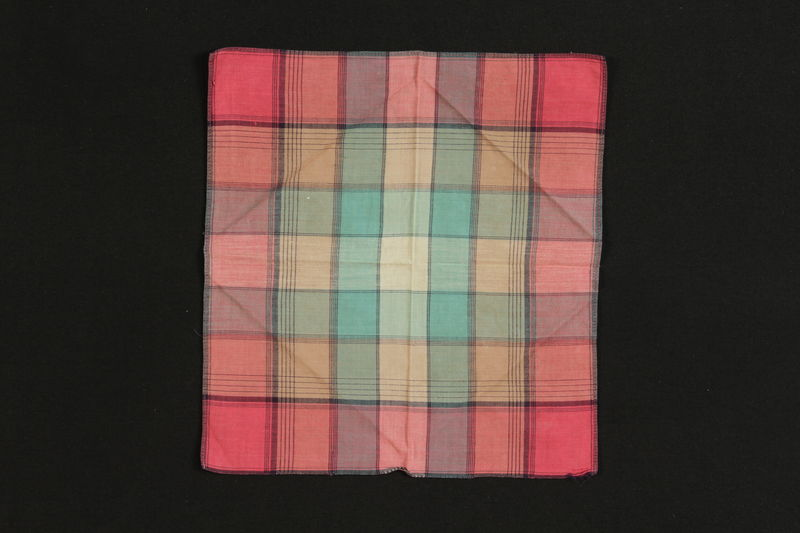 1988.99.3 front Colorful plaid handkerchief found by a German Jewish teenage inmate at Birkenau