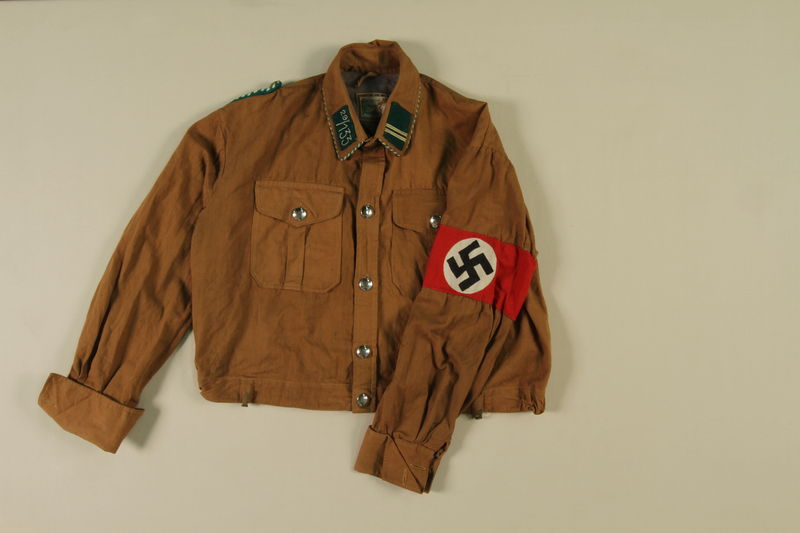 1988.99.5 front SA brown uniform shirt with Rottenfuhrer insignia acquired by a US soldier