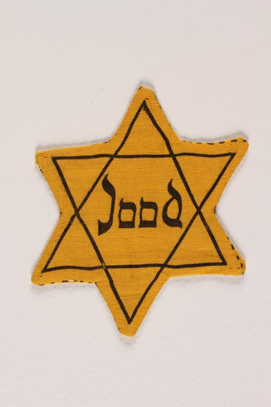 1993.4.10 front Star of David badge with Jood printed in the center