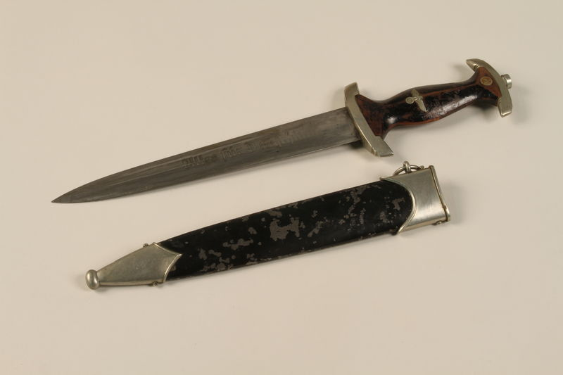 1989.10.5 open Wooden handled dagger with an embossed SA emblem and sheath acquired by a US soldier from German troops