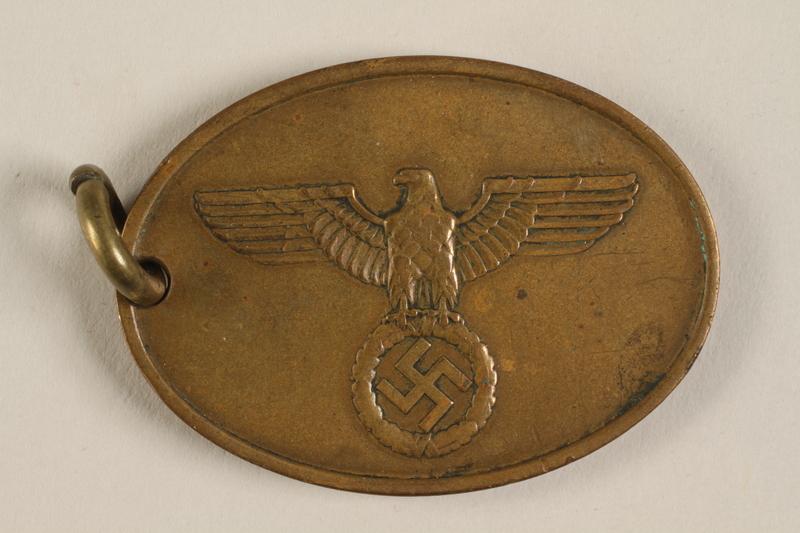 1993.56.1 front Oval warrant badge for the Staatliche Kriminalpolizei