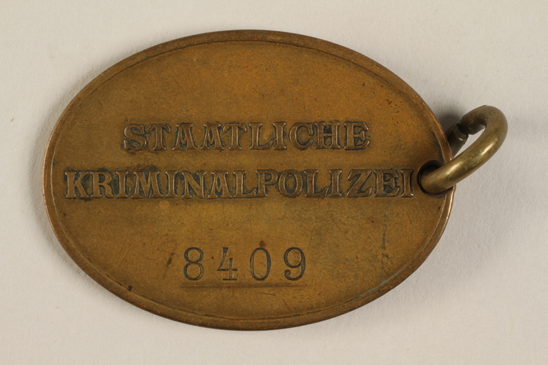 1993.56.1 back Oval warrant badge for the Staatliche Kriminalpolizei