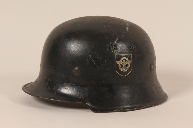 1993.71.1 left side Wehrmacht helmet found by a US soldier during the war