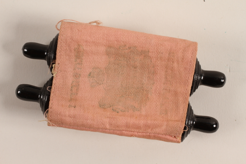 1993.85.1_a-b front Pink cloth Torah scroll cover saved by a refugee from Nazi Germany