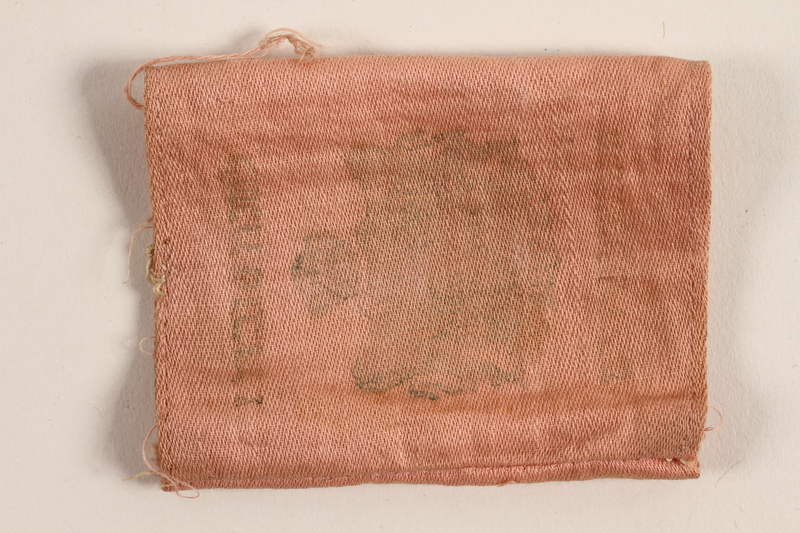 1993.85.1_b front Pink cloth Torah scroll cover saved by a refugee from Nazi Germany