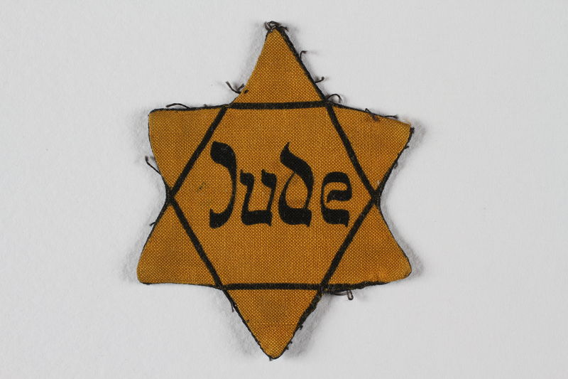 1993.88.1 front Star of David badge with Jude printed in the center