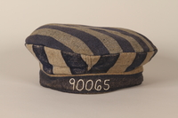 1993.90.3 front Concentration camp uniform cap with 90065 worn by a Polish Jewish inmate  Click to enlarge