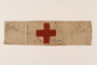 White armband with a red cross worn by a concentration camp inmate