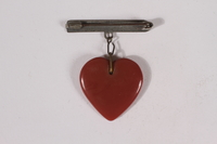 2014.480.28 back Stickpin with a painted glass heart acquired by a US soldier  Click to enlarge